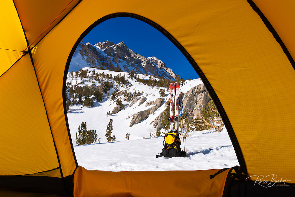 View from a yellow dome tent below Piute Pass in winter, Inyo National Forest, Sierra Nevada Mountains, California USA