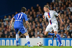 LONDON, ENGLAND - September 18: Chelsea's Oscar  and Basel's Fabian Frei during the UEFA Champions League Group E match between Chelsea from England and Basel from Switzerland played at Stamford Bridge, on September 18, 2013 in London, England. (Photo by Mitchell Gunn/ESPA)