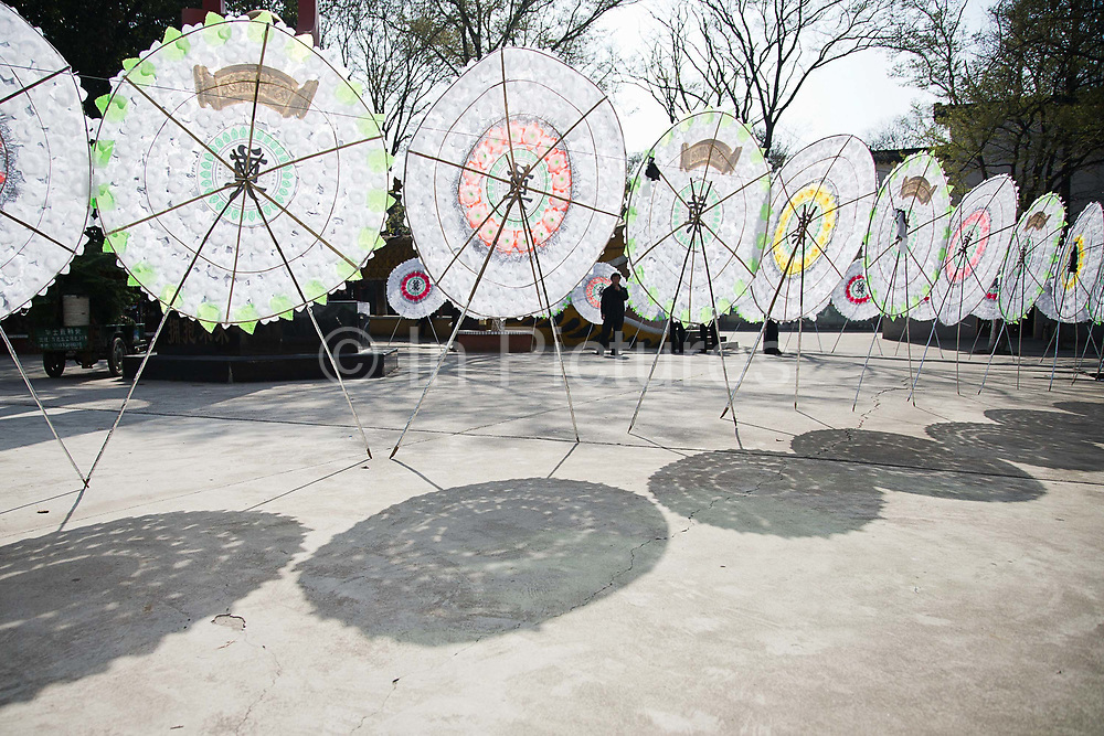 Paper flower reefs stand at the funeral ceremony site of late village party chief Wu Renbao lays at Huaxi, Jiangsu Province, China on 22 March  2012.  Wu is a outlier among local political leaders as his village is one of the wealthiest in China while remaining a collective, building up a personality cult that is much larger than his official title reflects.