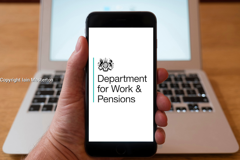 Using iPhone smartphone to display logo of the Department of Work and Pensions, UK Government