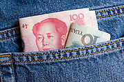 Chinese currency, one hundred and ten Yuan bills in jeans pocket