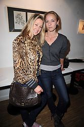 Left to right, ALICE BRUDENELL-BRUCE and CAROLINE HICKMAN at a private view of Henry Brudenell-Bruce's work held at 269 Portobello Road, London, W14 on 24th November 2009.