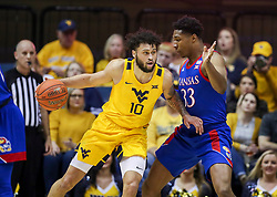 Feb 12, 2020; Morgantown, West Virginia, USA; West Virginia Mountaineers guard Jermaine Haley (10) makes a move against Kansas Jayhawks forward David McCormack (33) during the first half at WVU Coliseum. Mandatory Credit: Ben Queen-USA TODAY Sports