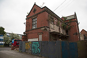 Street scene of a derelict building in Moseley, Birmingham, United Kingdom. Moseley is known as one of the more up market neighbourhoods in Birmingham, but still shows signs of downturn, and lack of consistent investment and general upkeep away from the residential areas, like here on Moseley Road.