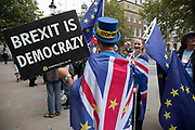On the day that Parliament was suspended for five weeks, anti-Brexit protesters including Steve Bray wave European Union flags outside the Cabinet Office in Westminster as inside Tory ministers gather on 10th September 2019 in London, England, United Kingdom.
