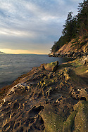 Sunset light on sandstone formations at Clayton Beach in Larrabee State Park - Bellingham, Washington State, USA