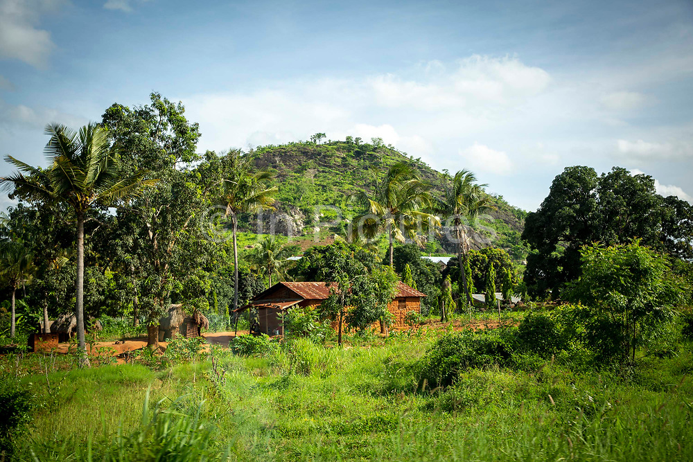 A small settlement next to a hill consisting of a house with a tin roof and a few out buildings on the outskirts of Morogoro the capital of the Morogoro Region on the 17th November 2019 in Morogoro, Tanzania.