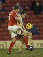 Photo: Aidan Ellis.<br /> Barnsley v Bristol City. Coca Cola League 1. 04/02/2006.<br /> Bristol's Marcus Stewart holds off Barnsley's Paul Reid