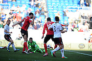 Cardiff city's Steven Caulker (4) shoots and scores his sides 1st goal. Barclays Premier league, Cardiff city v Fulham at the Cardiff city Stadium in Cardiff , South Wales on Sat 8th March 2014. pic by Andrew Orchard, Andrew Orchard sports photography