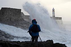 © Licensed to London News Pictures. 04/10/2019. Porthcawl, Bridgend, Wales, UK. Large waves hit the harbour wall as Storm Lorenzo, named after ex-hurricane Lorenzo, by Met Éireann, hits the Welsh seaside resort of Porthcawl in Bridgend, UK. Photo credit: Graham M. Lawrence/LNP