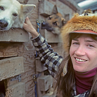 WHITEFISH, MONTANA. Dog team driver communes with her team during Winter Carnival.