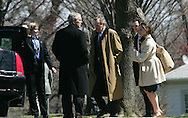 President George W.Bush and  President H.W. Bush talk as they walk from Marine One at the Naval Observatory to return to the White House. On right is Presidential daughter Barbara Bush and friend Jay Blount.   Marine One landed at the Naval Observatory because the South Lawn on the White House is being prepared for the East Egg Roll on Monday, March 24, 2008. Photo by Dennis Brack/Black Star