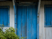 SANTIAGO DE CUBA, CUBA - CIRCA JANUARY 2020: Old wooden doors and windows in Cayo Granma in Santiago de Cuba