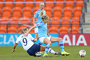 Tottenham Hotspur Women striker Rianna Dean (9) puts in a strong tackle on Manchester City Women defender Steph Houghton (6) during the FA Women's Super League match between Tottenham Hotspur Women and Manchester City Women at the Hive, Barnet, United Kingdom on 5 January 2020.