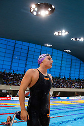 Rachael Kelly of Loughbrough University looks frustrated after failing to secure the World Championship qualifying time whilst winning the Womens 100m Butterfly Final - Photo mandatory by-line: Rogan Thomson/JMP - 07966 386802 - 16/04/2015 - SPORT - SWIMMING - The London Aquatics Centre, England - Day 4 - British Swimming Championships 2015.