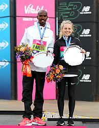 Mo Farah winner of the men's race and Charlotte Purdue winner of the women's race during the Vitality Big Half in London.