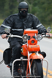 """Randy Aron riding his 1929 Harley-Davidson JD named """"Lucille"""" through the rain during Stage 6 of the Motorcycle Cannonball Cross-Country Endurance Run, which on this day ran from Cape Girardeau to Sedalia, MO., USA. Wednesday, September 10, 2014.  Photography ©2014 Michael Lichter."""