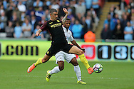 Aleksandar Kolarov of Manchester city is challenged by Wayne Routledge of Swansea city.  Premier league match, Swansea city v Manchester city at the Liberty Stadium in Swansea, South Wales on Saturday 24th September 2016.<br /> pic by Andrew Orchard, Andrew Orchard sports photography.
