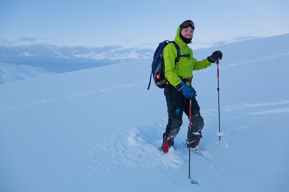 Nate Stevens makes ski turns at dusk on Hallwylfjellet, Svalbard.