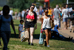 © Licensed to London News Pictures. 19/07/2016. London, UK. People enjoy the hottest day of the year so far in the UK in Green Park in London on Tuesday, 19 July 2016. Photo credit: Tolga Akmen/LNP