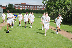 Group of secondary school students running during an athletics class,