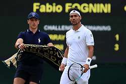 7 July 2017 -  Wimbledon Tennis (Day 5) - A ballboy presents Fabio Fogini (ITA) with his towel - Photo: Charlotte Wilson / Offside.