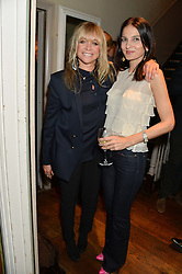 Left to right, JO WOOD and YAMIN MILLS at a party to celebrate the publication of 'Honestly Healthy For Life' by Natasha Corrett held at Bumpkin, 209 Westbourne Park Road, London on 26th March 2014.