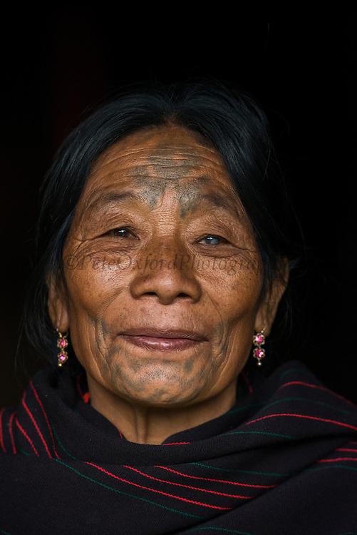 Chang Naga woman facial tattoos<br /> Chang Naga headhunting Tribe<br /> Tuensang district<br /> Nagaland,  ne India