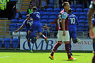 Cardiff City's Sean Morrison (4) celebrates by jumping on the back of goal scorer Nathaniel Mendez-Laing (19) after he scores his teams 1st goal. . EFL Skybet championship match, Cardiff city v Aston Villa at the Cardiff City Stadium in Cardiff, South Wales on Saturday 12th August 2017.<br /> pic by Carl Robertson, Andrew Orchard sports photography.