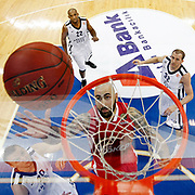 Anadolu Efes's (L-R) Dusko Savanoivc, Jamon Lucas, Sinan Guler and Olympiacos's Pero Antic during their Turkish Airlines Euroleague Basketball Group C Game 2 match Anadolu Efes between Olympiacos at Abdi ipekci Arena in Istanbul, Turkey, Friday, October 19, 2012. Photo by TURKPIX