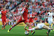 Swansea city's Chico Flores ® is at full stretch to stop Southampton's Daniel Osvaldo.  Barclays Premier League match, Southampton  v Swansea city at the St. Mary's stadium in Southampton on Sunday 6th Oct 2013. pic by Andrew Orchard, Andrew Orchard sports photography,