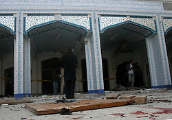 Pakistani security personnel inspect the suicide blast site in northwest Pakistan's Peshawar on Feb. 13, 2015. At least 19 people were killed and over 40 others injured in a twin suicide attack at a mosque of Shia Muslims in Pakistan's northwestern provincial capital of Peshawar Friday afternoon, officials said. EXPA Pictures © 2015, PhotoCredit: EXPA/ Photoshot/ Ahmad Sidique<br /> <br /> *****ATTENTION - for AUT, SLO, CRO, SRB, BIH, MAZ only*****