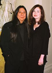 MR & MRS JOHN ROCHA he is the designer,  at a dinner in London on 20th November 1998.MMG 19