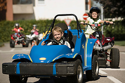 Children on driver training area