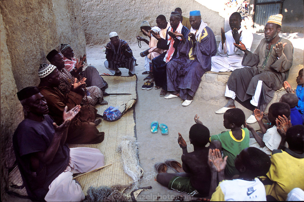 .Before the family broke the news to Pai that she was to marry her cousin, Baba, the imam, elders and other men of the family pray at the marriage agreement. According to custom, Pai will not know about the marriage arrangements until the morning of the ceremony. The couple will then spend the day apart, Pai weeping openly over the loss of her childhood. (Supporting image from the project Hungry Planet: What the World Eats.) The Natomo family of Kouakourou, Mali, is one of the thirty families featured, with a weeks' worth of food, in the book Hungry Planet: What the World Eats.
