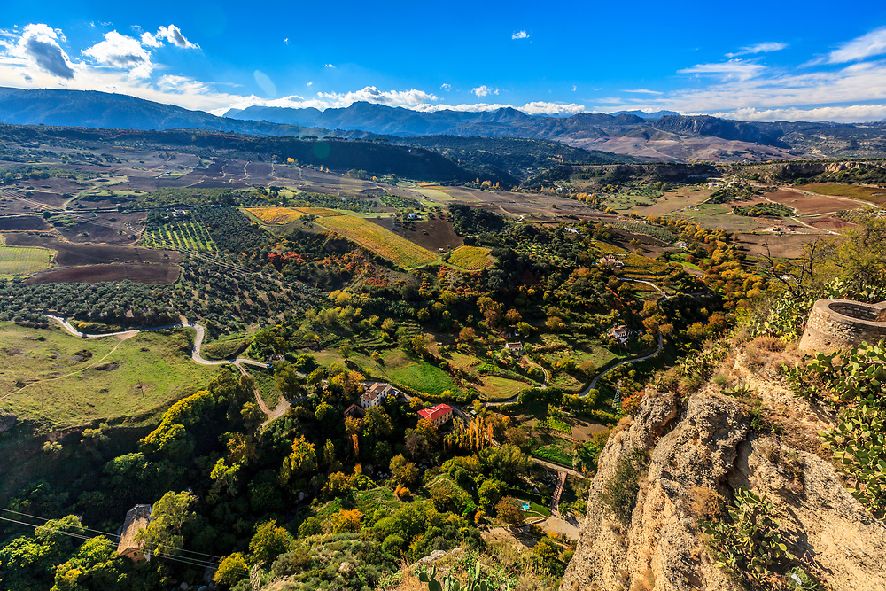 The rugged beauty of Tajo de Ronda and beautiful Guadalevín valley in Ronda, Spain. The Natural Park Sierra de Grazalema is seen on the horizon.