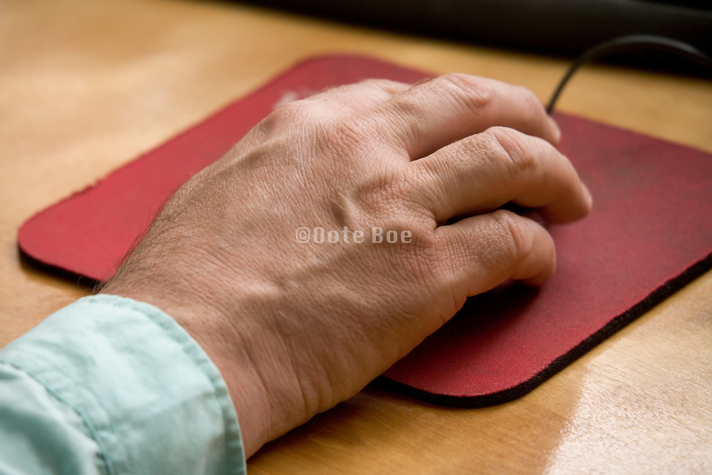 close up of male hand while working on the computer