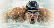 Michael Phelps swims in the men's individual medley at the U.S. championships swim meet, Friday, Aug. 6, 2010, in Irvine, Calif. Phelps came is second. (AP Photo/ Bret Hartman)