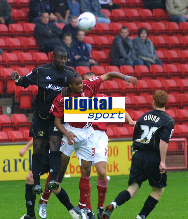 Photo: Dave Linney.<br />Walsall v Milton Keynes Dons. Coca Cola League 1.<br />08/10/2005. Leon Crooks/MK Dons and Ishmel Demontagnac (Walsall) during an aerial dual this afternoon at Bescot.