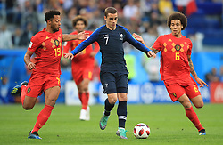 Belgium's (left-right) Mousa Dembele France's Antoine Griezmann and Belgium's Axel Witsel battle for the ball