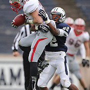 Jacob Supron, Brown, (left), is tackled by Myles Gaines, Yale,  during the Yale V Brown, Ivy League Football match at Yale Bowl. Yale won the match 24-17. New Haven, Connecticut, USA. 9th November 2013. Photo Tim Clayton