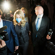 People walk through exhaust smoke from a tire burnout during a protest against police brutality and the killing of unarmed black people in Seaside, Calif. on May 30, 2020.
