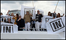 Image ©Licensed to i-Images Picture Agency. 15/06/2016. London, United Kingdom. Fishing for Leave flotilla. Bob Geldof on the IN Campaign boat gestures towards  UKIP's Leader Nigel Farage on board the Fishing for Leave  vessel joining the Leave Flotilla going up the Thames to Parliament campaigning to Vote out of the referendum on June 23rd 2016.  Picture by Andrew Parsons / i-Images