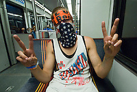 A demonstrator rides the lightrail train after an Iraq Veterans Against the War protest at the 2008 Democratic National Convention on in Denver.