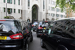 """Mayfair, London, May 24th 2016. Drivers from minicab operator Addison Lee bring traffic to a standstill in Berkely Square, outside of the offices of owner Carlyle Group, in protest against new """"unfair"""" pay rates as the company battles to compete with cut-price Uber, with some drivers claiming they are earning as little as £4.99 per hour. PICTURED: Minicabs sound their horns outside Landsdowne House, where Carlyle Group is headquartered."""