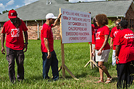 Concerned Citizens of St Jophn the Baptist puting up signs in Reserve, Louisiana.