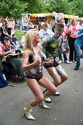 Man and woman dancing at Nottingham's 2005 Gay Pride Lesbian festival; held at the Arboretum,