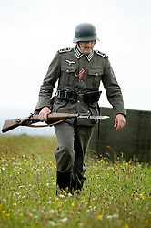 Member of the Northern World War Two Association portraying a soldier from 8th Company 2nd Battalion Grossdeutschland Division German Army with fixed bayonet and K98 rifle . Scarborough Castle Saturday 29th May 2010 .<br /> Image © Paul David Drabble
