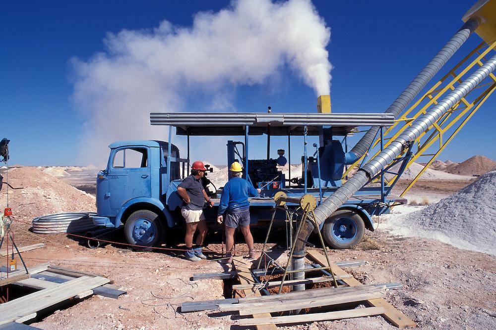 Australia, South Australia, Dust from dynamite blast billows from a blower at Stuart Bird's opal mine in Coober Pedy.