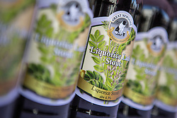 © Licensed to London News Pictures. 12/07/2015. Pontefract, UK. Picture shows Liquorice beer. Thousands of people have again turned out in Pontefract to celebrate all things Liquorice including sweets, beer, bread, pies, jam & jewellery . The town famed for the Pontefract cake has a 400 year history with Liquorice, it is believed Cluniac monks brought it to the area in the mid 1500 & introduced it as a medicine. Photo credit : Andrew McCaren/LNP